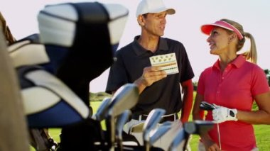 Male and female golf players on golf course — Stock Video