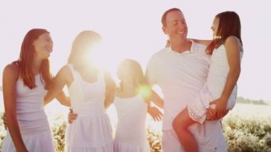 Parents with daughters embracing together — Stock Video