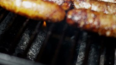 Sausages grilling chargrilled barbecue — Stock Video