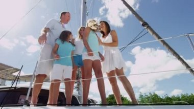 Parents and daughters on luxury yacht — Stock Video