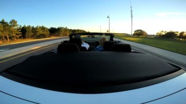 Couple driving in luxury cabriolet car — Stock Video