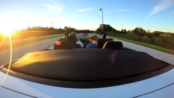 Couple driving in luxury cabriolet car — Vídeo de stock