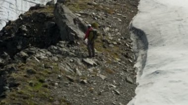 Climber travels on Alaska glacier mountains — Stock Video