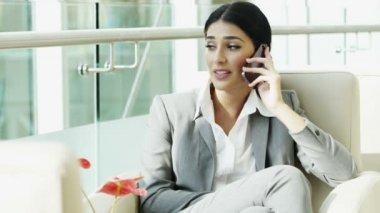 Businesswoman in business suit talking on smart phone — Stock Video