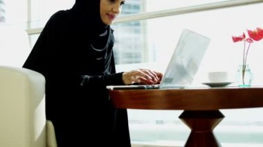 Businesswoman working on laptop and talking on smart phone — Stock Video