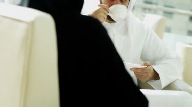 Arabic businessman and businesswoman discussing in office — Stock Video