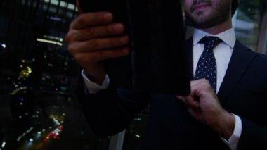Arabic businessman using digital tablet at night — Stock Video