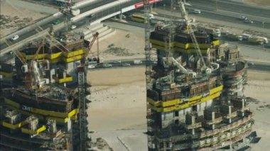 Aerial construction cranes high Dubai development — Stockvideo