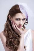 Gorgeous Red head bride holding her face — Stock Photo