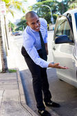 Young Black Inspector inspecting ,evaluating a car — Stock Photo