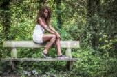 Model in the woods — Stockfoto