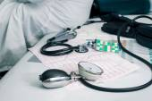 Stethoscope, pills and ECG — Stock Photo
