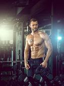 Man posing in gym — Stock Photo