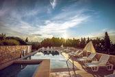 Hotel pool at Mediterranean coast — Stock Photo