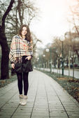 Young elegant girl in park during autumn — Stock Photo