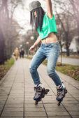 Girl roller skating in park — Stock Photo