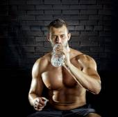 Man drinking water in gym — Stock Photo