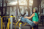 Girl relaxing on gym cycling machine — Stock Photo