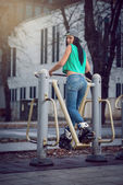 Girl doing exercise in public open air gym — Стоковое фото