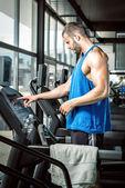 Man setting treadmill — Stock Photo