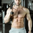 Man doing rope extension exercise — Stock Photo #75877909