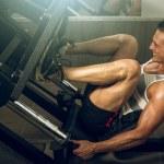 Man using leg press in gym — Stock Photo #78838768