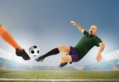 Soccers striking the ball — Stock Photo