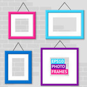 Set Of Photo Frames On A Wall — Stock Vector