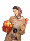 Woman with autumn apples in basket — Stock Photo