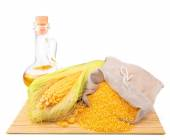 Composition from corn, maize flour in sack, oil on the mat — Stock Photo