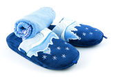 Blue soft slippers with towel — Stock Photo