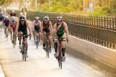 Calella, Spain, May 18. Triathletes ride speed cycles on the Ironman triathlon competition at Calella beach, May 18, 2014 in Calella, Spain — Stock Photo