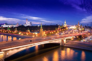 Night aerial panorama to Bolshoy Moskvoretsky Bridge, Vasilevsky Descent, towers of Moscow Kremlin, Saint Basil Cathedral and Moskva river, Moscow, Russia