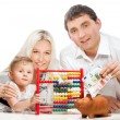 Young family with moneybox — Stock Photo #52815195
