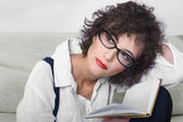 Woman in glasses with book — Stock Photo
