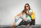 Stylish girl with yellow handbag — Stock Photo