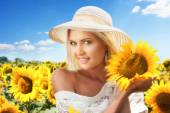 Woman in blooming sunflower field — Stock Photo