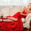 Blond woman in  red dress — Stock Photo #58102447