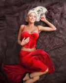 Blond woman in  red dress — Stock Photo