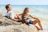 Young couple in love on beach — Stock Photo