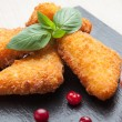 Fried cheese sticks served with cranberries, sauce on black ston — Stock Photo #56042327