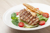 Gourmet caesar salad with grilled meat fillet, cherry tomatoes,  — Stock Photo