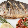 Gourmet Mediterranean seafood dish. Grilled fish gilthead with v — Stock Photo #63605197