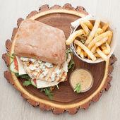 Wheat chicken sandwich burger, fried potatoes, mustard sauce. Se — Stock Photo
