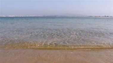 Olhão city and Armona island at Ria Formosa. View from Farol island inlet, wetlands conservation region landscape, Algarve, southern Portugal — Stock Video