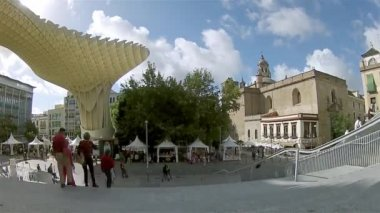 SEVILLE, SPAIN - OCTOBER 2014: Pan Timelapse shot in Metropol Parasol in Plaza de la Encarnacion on 12 of October 2014 in Sevilla,Spain. — Stock Video
