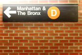 New York City Station subway directional sign on tile wall. — Stock Photo