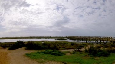 Algarve golf course scenery at Ria Formosa conservation marsh landscape, famous golf and nature destination, Portugal. (Pan Timelapse) — Stock Video