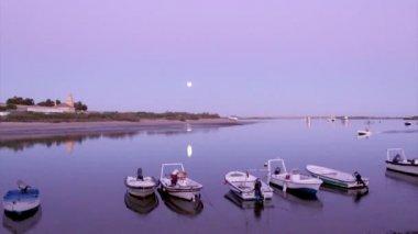 Dusk in Quatro-Aguas Recreational Port and ferry boat pier to Tavira island in Ria Formosa Natural Reserve. Algarve, Portugal. — Vídeo de stock