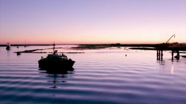 Dusk in Quatro-Aguas Recreational Port and ferry boat pier to Tavira island in Ria Formosa Natural Reserve. Algarve, Portugal. — Stockvideo